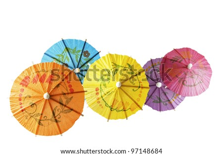 Multicolored Cocktail Umbrellas, spring and summer symbol,isolated on white background - stock photo