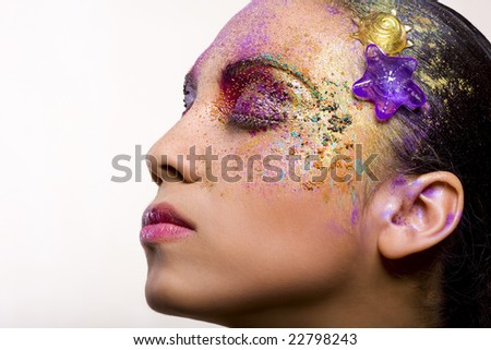 Multicolored creativity make-up with stylish hairstyle.