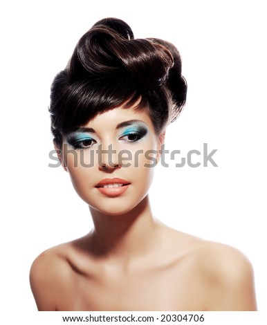 Multicolored creativity make-up with stylish hairstyle. Close-up portrait of young beautiful woman. - stock photo