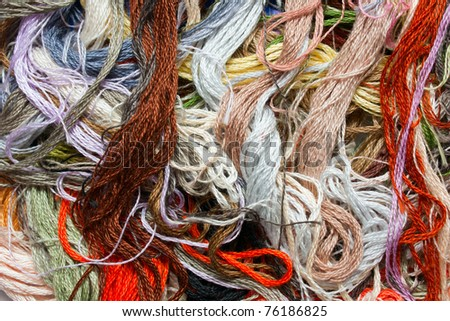 Multicolored cross-ctitch threads close up - stock photo