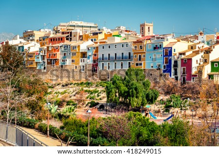 Multicolored crowded houses of Villajoyosa / La Vila Joiosa town. Coastal town of Costa Blanca. Province of Alicante, Valencian Community, Spain