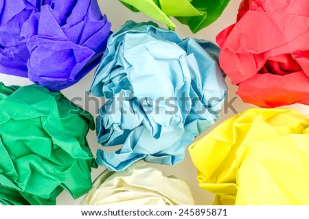 Multicolored crumpled balls of paper - stock photo