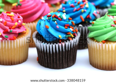 Multicolored Cupcakes Isolated on a White Background - stock photo