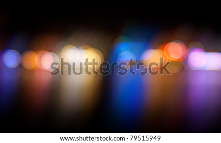 Multicolored defocused lights in the city at night - stock photo