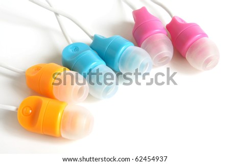 Multicolored earphones on a white background