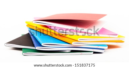 multicolored exercise books