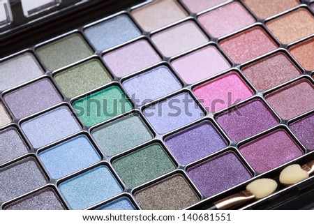 multicolored eye shadows palette on a white background, selective focus - stock photo