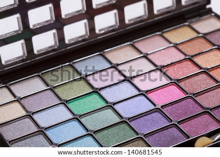 multicolored eye shadows palette on white background, selective focus - stock photo