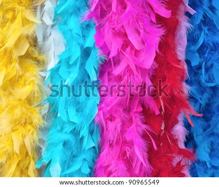 Multicolored feather boas for fancy dress costume.