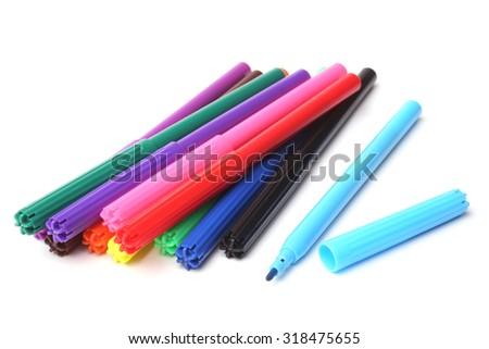 Multicolored felt tip pens on white background - stock photo