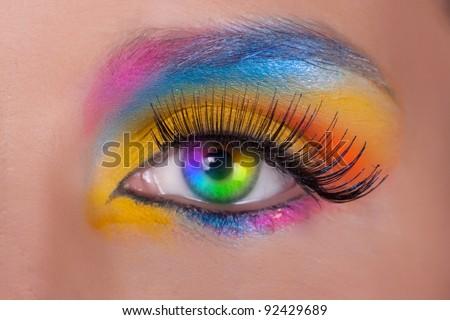 Multicolored female eyes. Close up. - stock photo