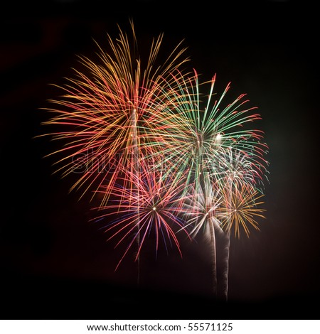 Multicolored fireworks against a black night sky square - stock photo