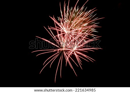 Multicolored  fireworks with dark sky background,  explode, on black background close up with the space for text  - stock photo
