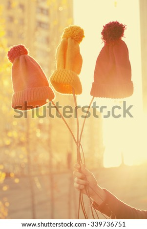 Multicolored funny woolen knit hats. Picture in vintage style instagram - stock photo