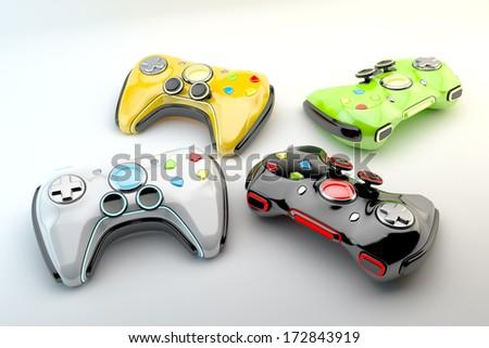 Multicolored game pads / Stylish modern wireless joystick - stock photo
