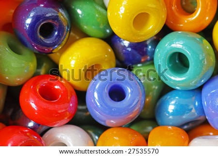 Multicolored glossy beads, macro. - stock photo