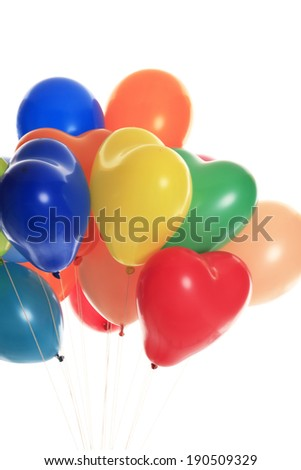 Multicolored helium party balloons, some heart-shaped