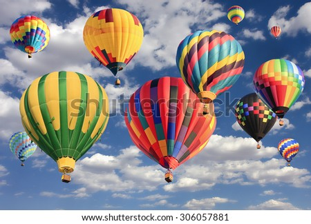 Multicolored hot air balloons flying - stock photo