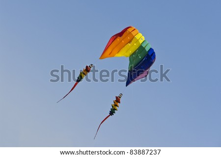 Multicolored kite in blue sky