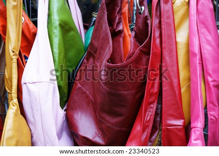 multicolored leather bags on street market - stock photo