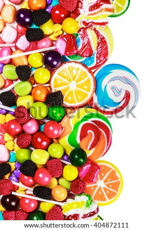 multicolored lollipops, candy and chewing gum on a white background - stock photo