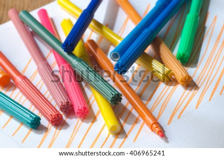 multicolored markers and white paper sheet - stock photo