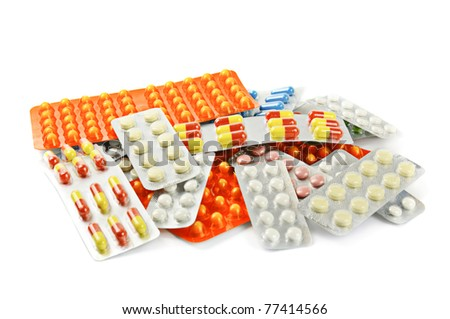 Multicolored medicine pills on the white background - stock photo