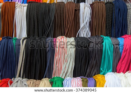 Multicolored multishoelaces with variety styles for sale in the market , Textured background - stock photo