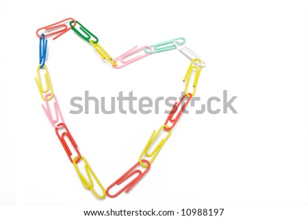 multicolored paper-clip like heart on the white isolated background - stock photo