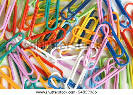 Multicolored paper clips on a white background - stock photo