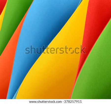 Multicolored papers forming abstract background - stock photo