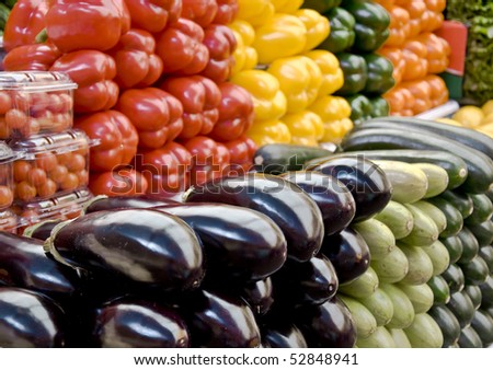 Multicolored particulars vegetables on the grocery market. Multicolored and freshness. Close-up, blurred focus - stock photo