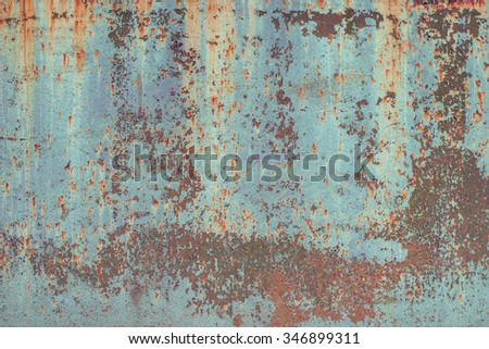 Multicolored peeled metal surface texture background. Vintage effect. - stock photo