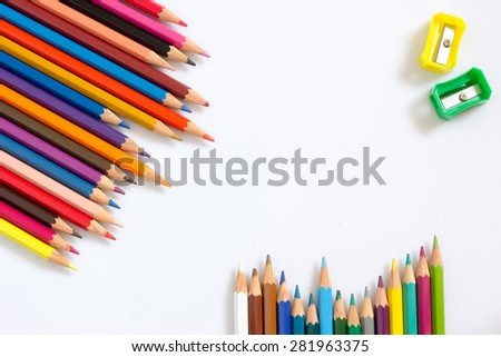 multicolored pencils growing row and colors sharpener with shadow on white background ,Color pencils Background for business presentation - stock photo