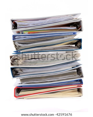 Multicolored pile of binders / files with papers