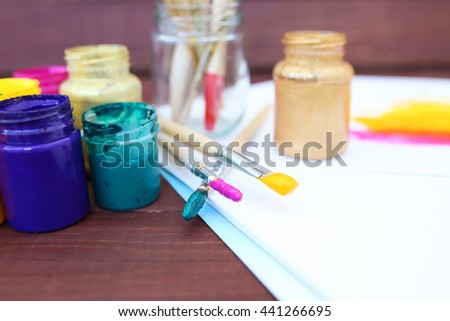 Multicolored plastic cans with paints. Artist workplace background. Art tools. Paints background. Colorful artist palette. Soft toned. Creativity, visual art concept. Art and craft. Closeup - stock photo