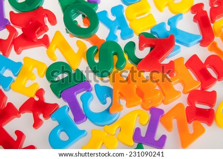 Multicolored plastic letters. Alphabet background