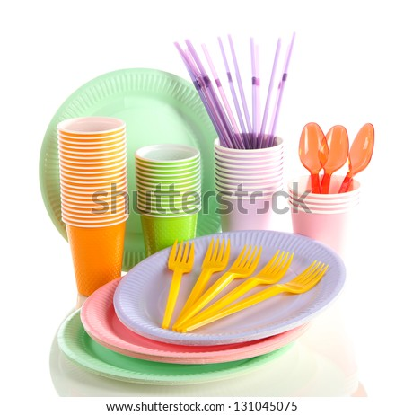 Multicolored plastic tableware isolated on white - stock photo