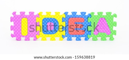 Multicolored plastic toy letters spelling the word Idea isolated on a white background.  - stock photo