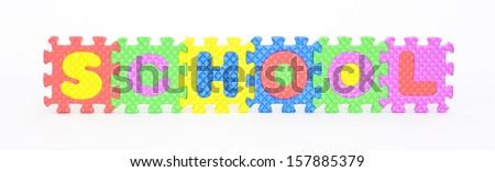 Multicolored plastic toy letters spelling the word School isolated on a white background.  - stock photo