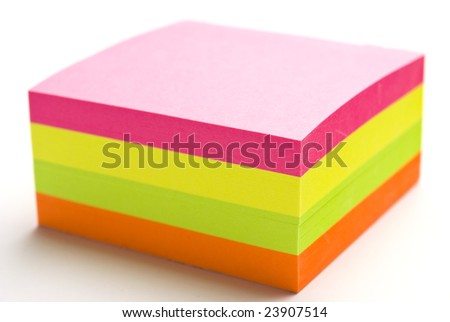 Multicolored post it note block with narrow depth of field - stock photo