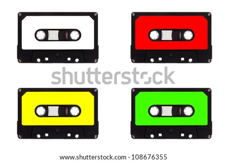 Multicolored quartet of cassettes, isolated on white background - stock photo