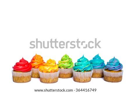 Multicolored rainbow cupcakes - stock photo
