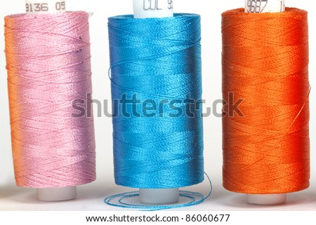 multicolored rainbow threads for sewing - stock photo