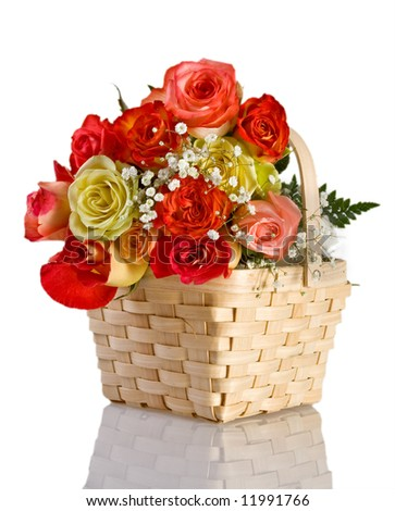 Multicolored roses in a basket - stock photo