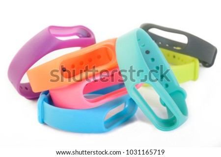 multicolored rubber wristband on white background