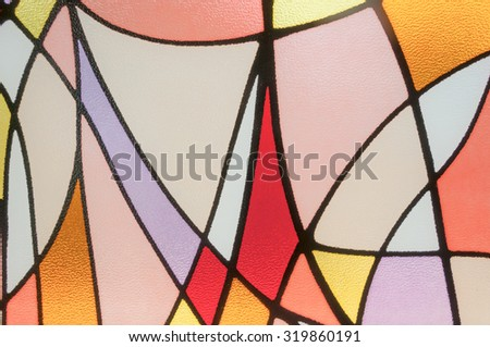 Multicolored stained glass church window - stock photo