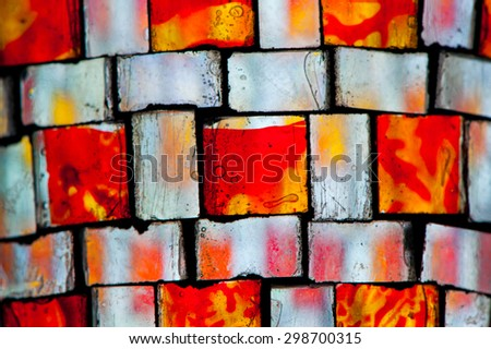 multicolored stained glass with irregular square block pattern
