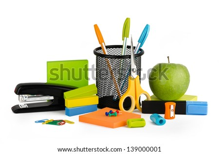 Multicolored stationery set with a green apple on a white background - stock photo
