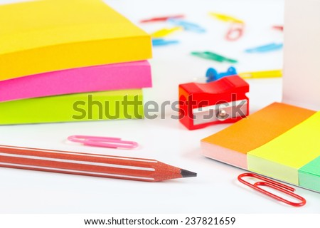 Multicolored stationery supplies on white desktop close up - stock photo